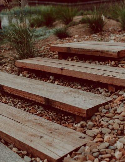 Closeup photo of timber steps in Australian native garden