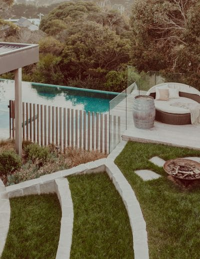 Photo of stone and grass landscaping next to pool area