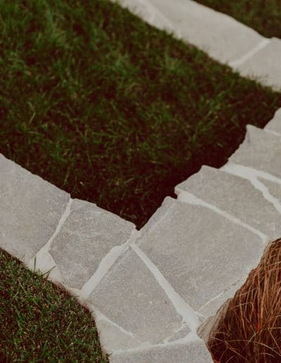 Photo of stone retaining walls with grass steps