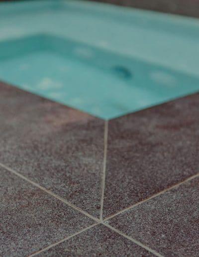 Closeup photo of paving next to pool
