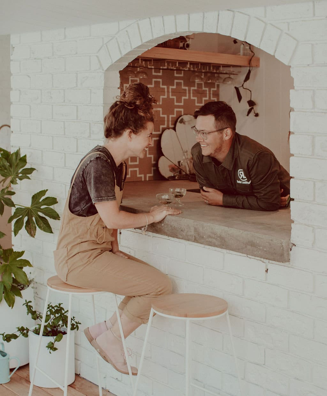 Photo of Radar Landscapes directors sitting at a backyard bar